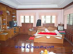 Master Bedroom in Villa with many windows