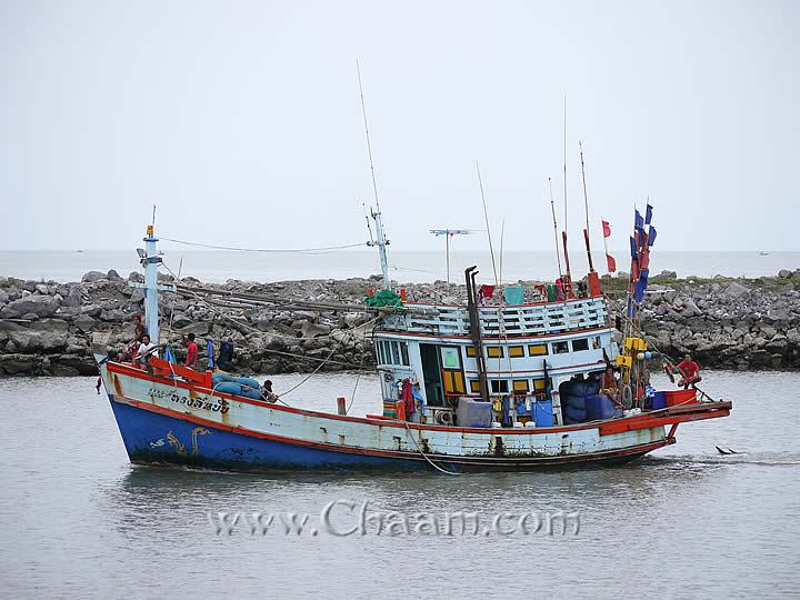 Fishing boat drives in harbor of Cha-Am