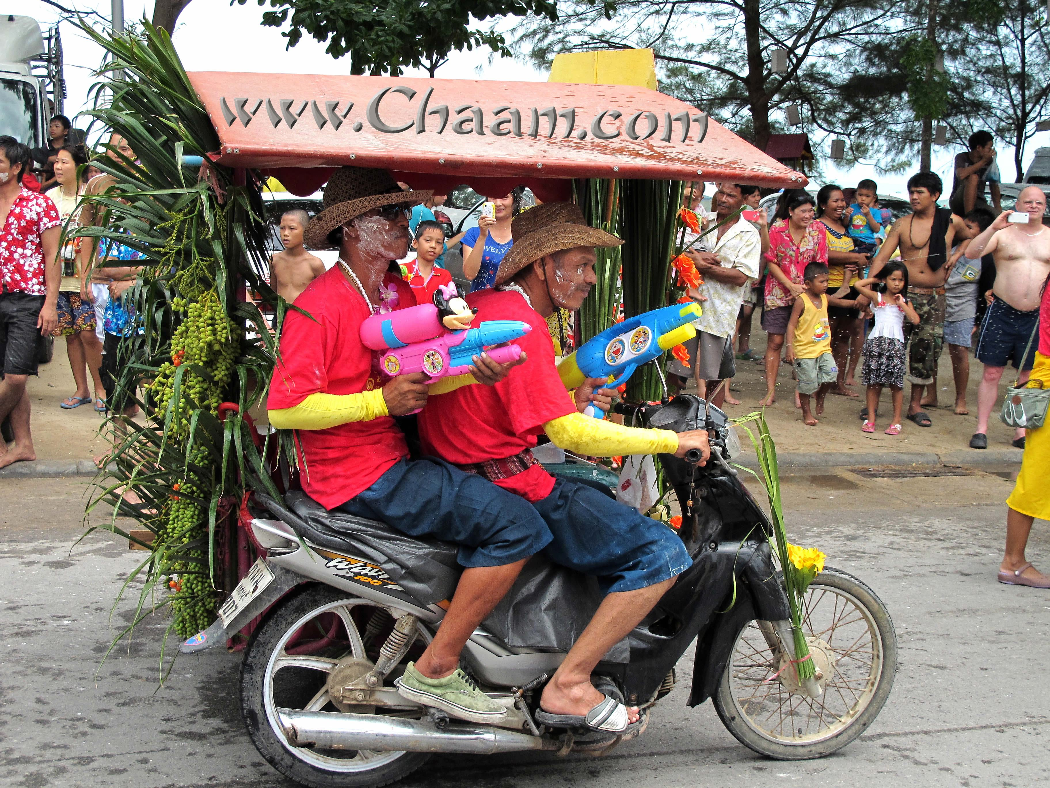 Farmers on motorbike in Cha-Am Thailand